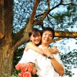 Asian chinese couple in intimate moments outdoor — Stock Photo