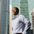 Ambitious young asian man with buildings in the background — Stock Photo