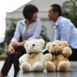 Modern couples in love in city with teddy bears — Stock Photo #6718805