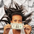 Asian Chinese woman with a US dollar bill - Stock Photo