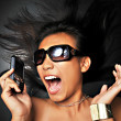 Asian Chinese woman yelling into her handphone — Stock Photo