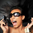 Asian Chinese woman yelling into her handphone — Stock Photo #6719627