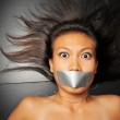 Asian chinese girl with tape over her mouth — Stock Photo #6719755