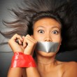 Asian chinese girl with tape over her mouth — Stock Photo #6719771