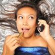 Asian chinese girl on her way to party with handphone — Stock Photo #6719825