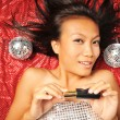 Asian Woman with a lipstick preparing for a party — Stock Photo #6719841