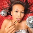 Asian Woman with a lipstick preparing for a party — Foto de Stock