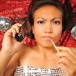 Asian chinese girl on her way to party with handphone — Stock Photo #6719913