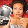 Asian chinese girl on her way to party with handphone — Stock Photo