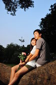 Asian Chinese couple in love in a park — Stock Photo