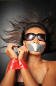 Asian chinese girl with tape over her mouth — Stock Photo