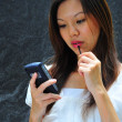Asian chinese office lady using her mobile communicator — Foto de Stock