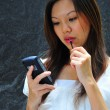 Asian chinese office lady using her mobile communicator — Stock Photo #6723425
