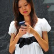 Asian chinese office lady using her mobile communicator — Stock Photo