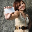 Young asian chinese girl holding namecard with textured background — Stock Photo