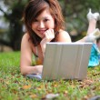 Asian Chinese girl with her laptop outdoors — Stock Photo #6723631