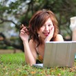 Asian Chinese girl with her laptop outdoors — Foto Stock