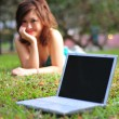 Asian Chinese girl with her laptop outdoors — Stock Photo