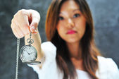 Asian chinese lady showing that time is important — Stock Photo