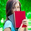 Stock Photo: Beautiful Teen with Book