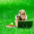 Beautiful girl listening to music in the park — Stock Photo