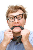 Crazy businessman with a tie in the mouth — Stock Photo