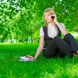Business woman with phone on grass — Stock Photo