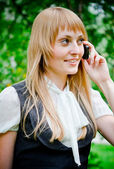 Beautiful woman portrait at outdoors talking cell phone — Stock Photo