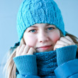 Beautiful girl in winter clothes - Stock Photo