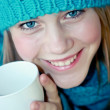 Girl with a cup of hot tea — Stock Photo