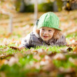 Baby in autumn — Stock Photo