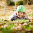 Baby in autumn — Stock Photo #6269535
