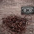 Cassette on wooden background — Stock Photo
