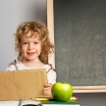 Schoolchild in classroom — Stock Photo