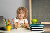 Schoolchild in class — Stock Photo