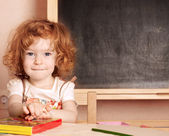 Schoolchild in a class — Stock Photo