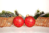 Christmas border from branch and balls — Stock Photo