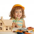 Happy child builds house — Stock Photo