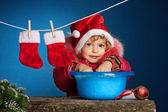 Child in Santa hat — Stock Photo