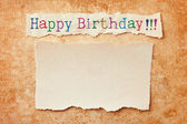 Paper with ripped edges on grunge paper background. Happy birthd — Zdjęcie stockowe