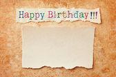 Papel con los bordes rotos sobre grunge de papel. happy birthd — Foto de Stock