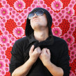 Stock Photo: Emotional young min love on flowers background. Valentine's D