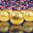 Royalty-Free Stock Photo: Golden christmas decoration balls on christmas lights background