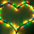 Shining heart on dark green background. Valentine's Day — Stock fotografie