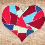 Fabric scraps heart on texture grunge background. Valentine's Da — Stock Photo #6479590