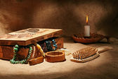 Still-life with wooden casket — Stock Photo