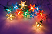 Christmas lights on dark background with copy space. Decorative — Stock Photo