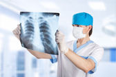 Medical doctor looking at x-ray picture of lungs in hospital — Stock Photo