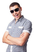 Smiling happy young man in sunglasses isolated on white backgrou — Stock Photo