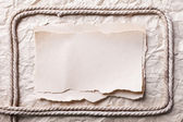 Ripped piece of paper and rope on old crushed paper background. — Stock Photo